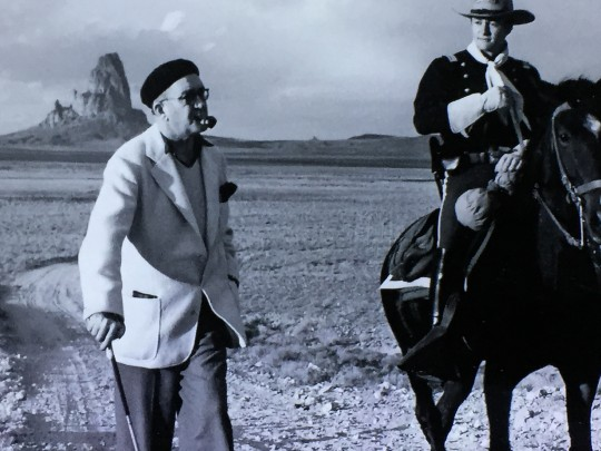 John Ford on the location of Stagecoach, with Agathla in the background